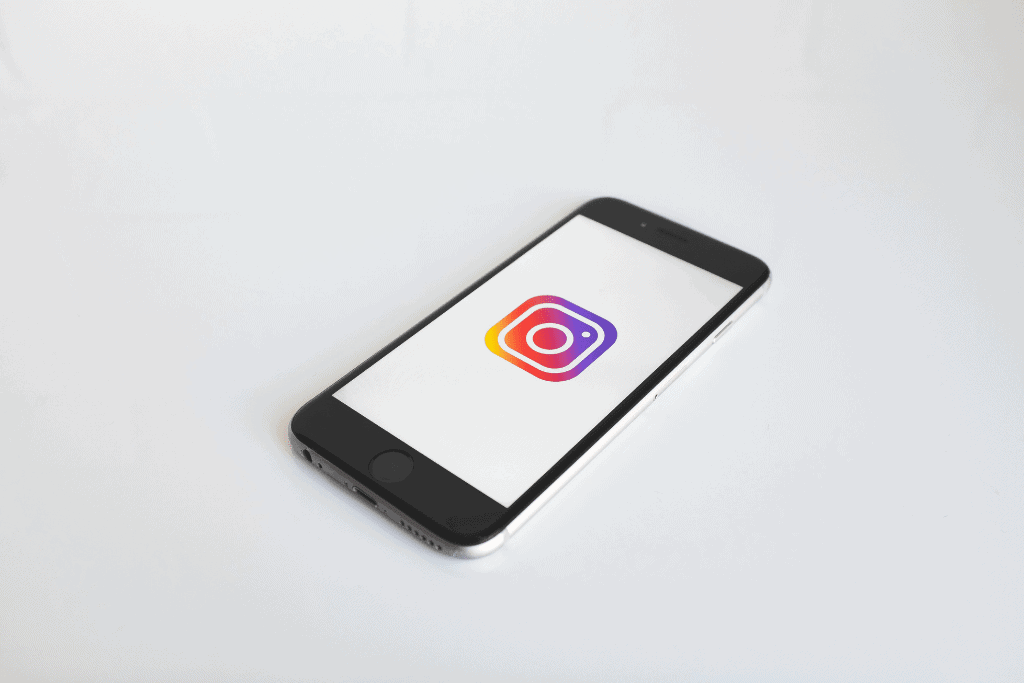 A smartphone on a plain background with an instagram logo