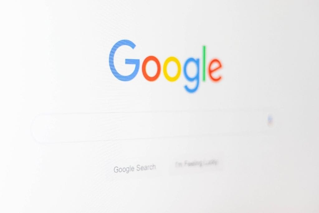 The main google page shown on a laptop screen
