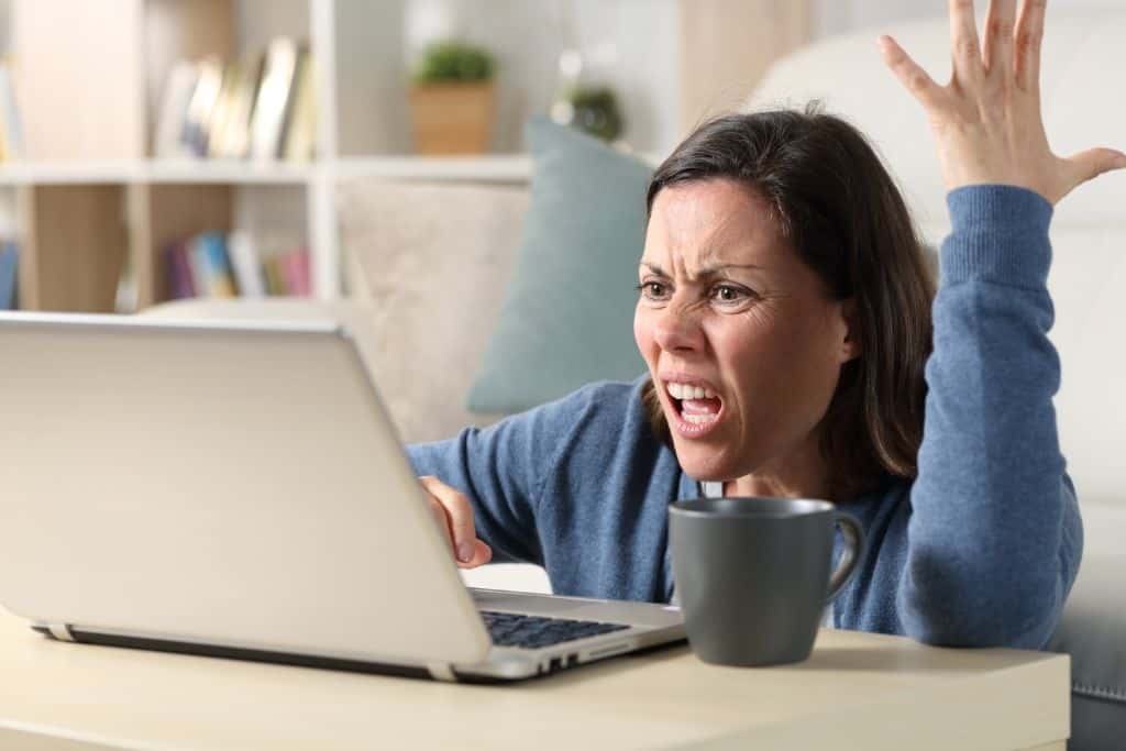 Angry woman watches a screen